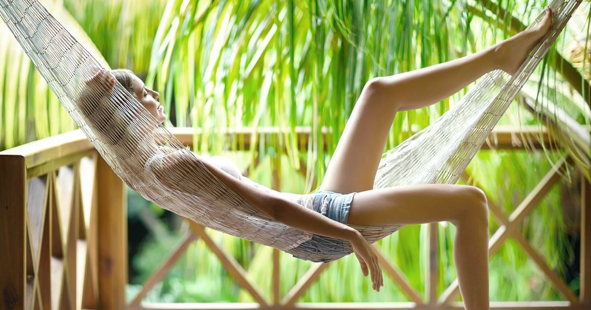 Young woman relaxing on hammock without technology