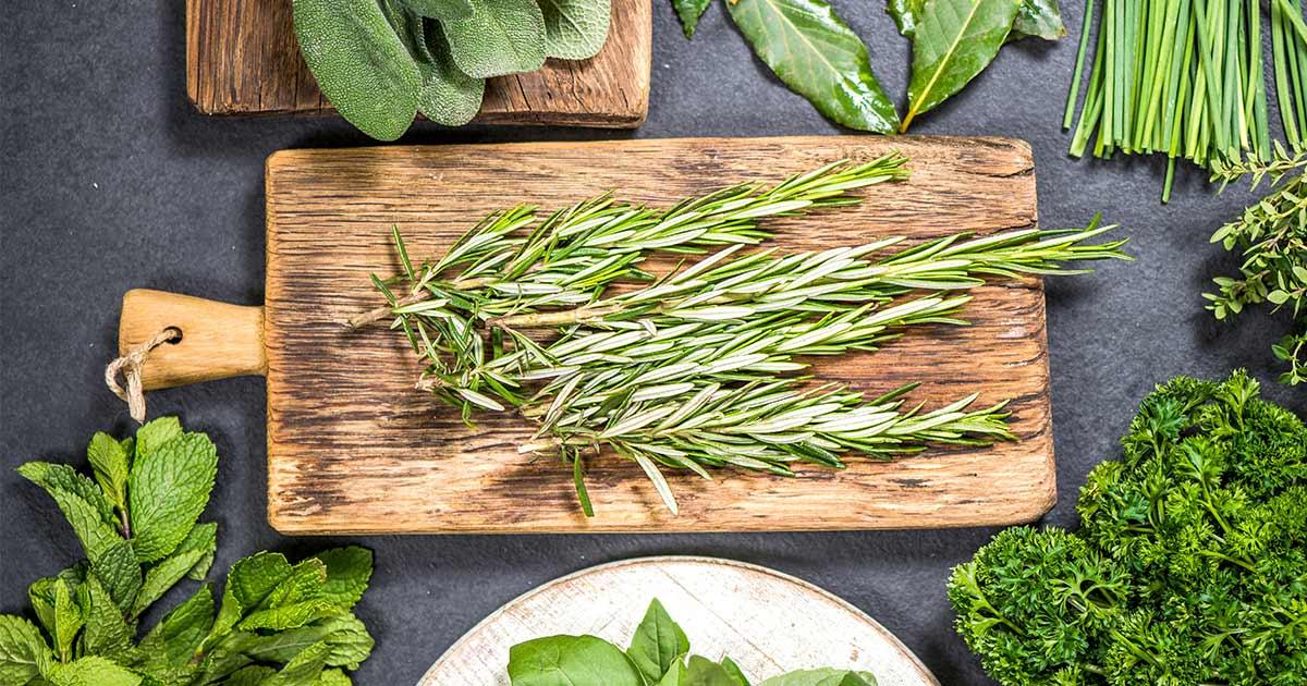 Antioxidant rich rosemary on a wodden cutting board