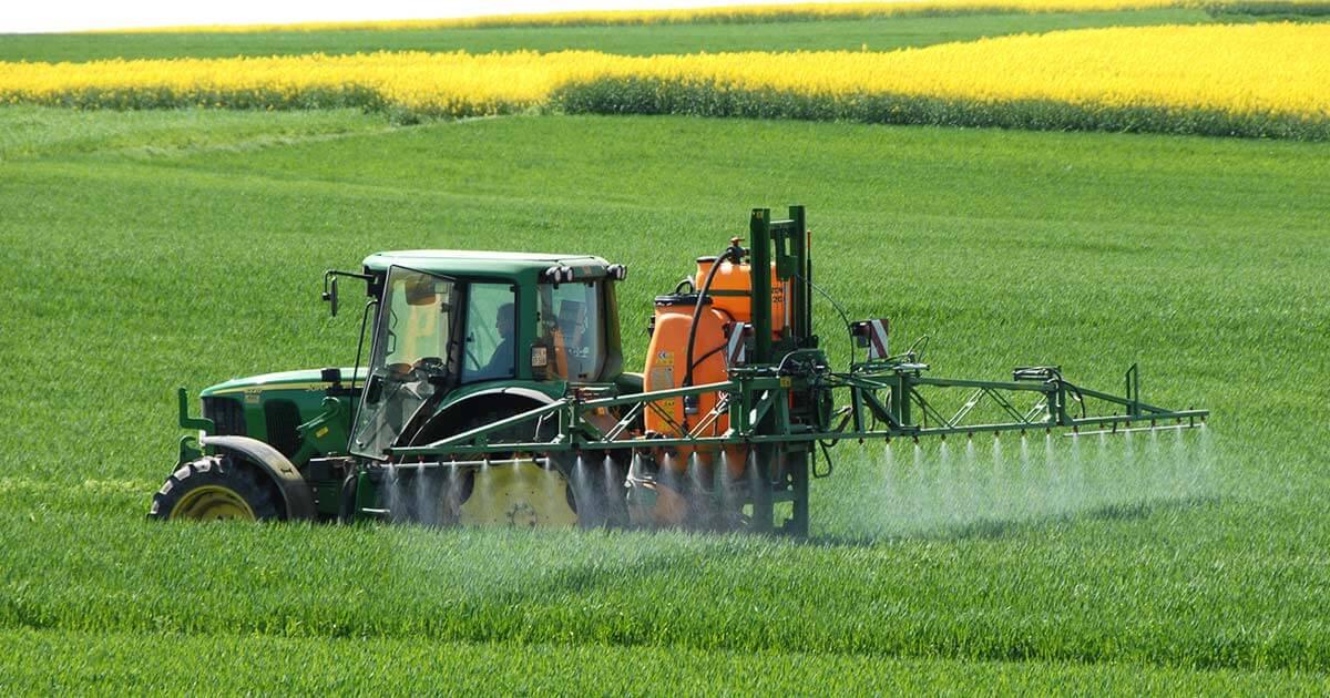 Farmer spraying toxic glyphosate on crops